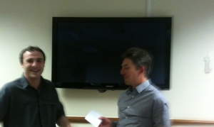 Ritchie Brown presents Stephen Dix with the Tall Tales prize.