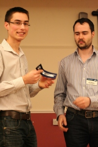 Edward Kutas receives his IceBreaker ribbon from Club President Kevin Miller